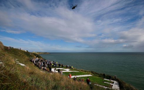 SIGN OF THE TIMES: Relatives of Coastal Watching Service members who constructed the Éire 7 sign to warn aircraft Ireland was neutral territory during wartime at Hawk Cliff gather as the sign is commemorated on the Vico Road, Dalkey, Dublin. Photograph: Nick Bradshaw