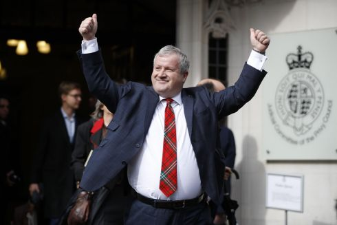 VINDICATION: Scottish National Party Westminster leader Ian Blackford raises his arms as he comes out to speak to the media outside the supreme court in London after the court ruled Boris Johnson's advice to the queen to suspend parliament was unlawful. Photograph: Tolga Akmen/AFP/Getty Images