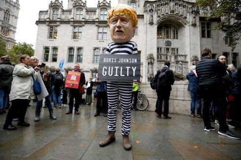 HUMILIATION: A man wearing a giant Boris Johnson mask, dressed as a prisoner, outside the supreme court in London. Photograph: Jonathan Brady/PA Wire