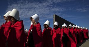 Activists in Argentina  disguised as characters from The Handmaid's Tale.  In hellish, dystopian Gilead, handmaids are given the names of their captors as a way of obliterating their dignity. Photograph:  Alejandro Pagni/AFP/Getty Images