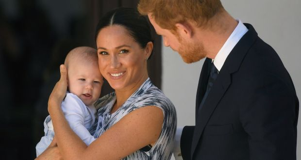 Britain's Prince Harry (R), Duke of Sussex and his wife Meghan, Duchess of Sussex, holding their son Archie in Cape Town, South Africa. Photograph: Toby Melville/EPA/pool