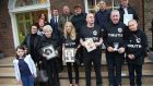 Victims' family members at  Buswells Hotel after the announcement that  the Stardust blaze will be subject to  a fresh inquest. Photograph:  Stephen Collins/Collins Photos