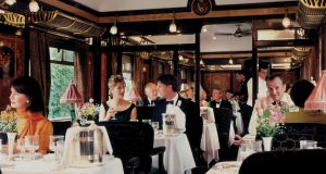 Passengers enjoying dinner in dining car 'Etoile du Nord' on the Orient Express.