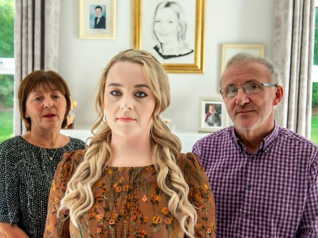 A portrait of Nichola Sweeney hangs behind Sinead O'Leary and Nichola's parents, Josephine and John. Photograph: Michael Mac Sweeney/Provision