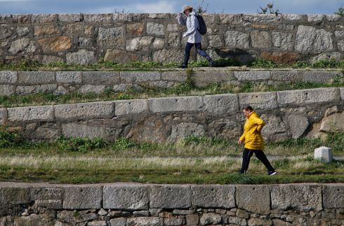 COASTAL SHELF: Walkers on Dún Laoghaire pier. Photograph: Nick Bradshaw/The Irish Times