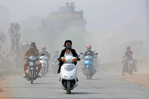 AIR GRIEVANCES: A motorcyclist in Hanoi, Vietnam, travels amid air pollution. Photograph: Minh Hoang/EPA
