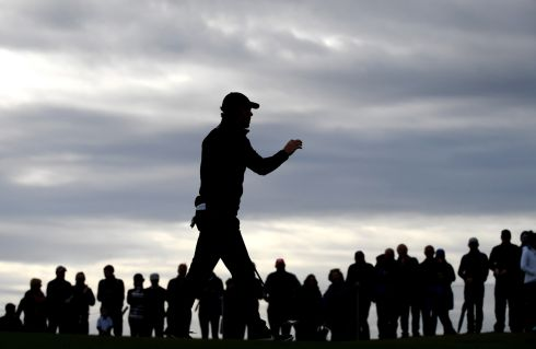 SHADOW PLAY: Rory McIlroy of Northern Ireland acknowledges the fans during day two of the Alfred Dunhill Links Championship in St Andrew's, UK. Photograph: Ross Kinnaird/Getty Images