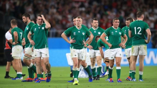 Ireland players stand dejected after the defeat. Photo: Adam Davy/PA Wire