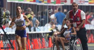 Giovanna Epis of Italy receives medical attention. Photograph: Ali Haider/EPA