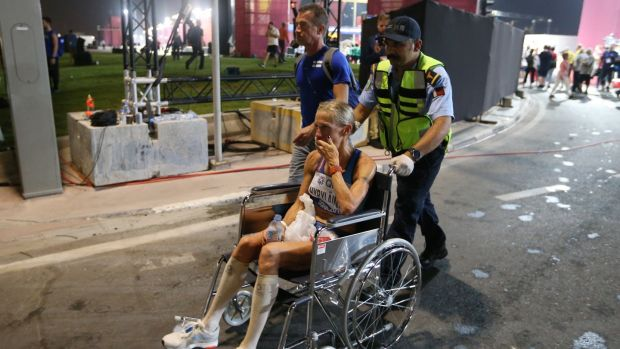 Anne-Mari Hyrylainen of Finland receives medical attention after finishing the marathon . Photograph: Ali Haider/EPA