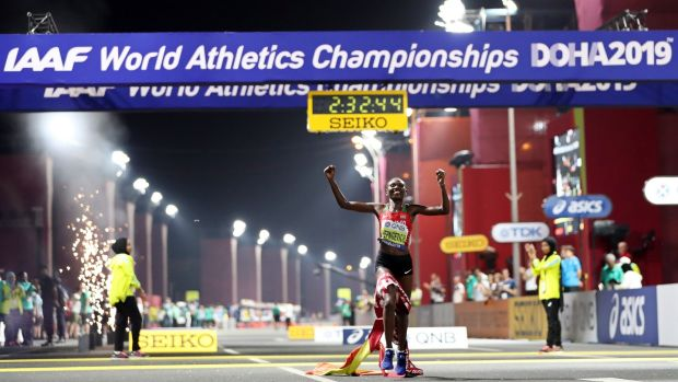 Ruth Chepngetich of Kenya celebrates while crossing the finish line to win the women's marathon at the IAAF World Athletics Championships at the Al Corniche Water Front in Doha. Photograph: Ali Haider/EPA