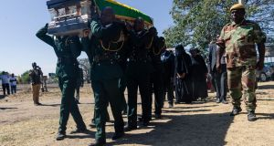 The coffin of former president of Zimbabwe Robert Mugabe is taken for burial at his home village in Kutama. Photograph: Jekesai Njikizana/AFP/Getty Images