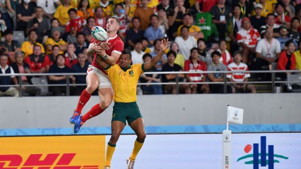 George North leaps to try and claim the ball ahead of Kurtley Beale during Wales' win over Australia. Photograph: Toshifumi Kitamura/AFP/Getty