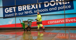 A worker walks past the Conservative Party branded sign that reads 'Get Brexit Done' outside Manchester Central convention complex ahead of the party's annual conference. Photograph: Oli Scarff/AFPGetty Images