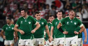 Ireland's players react after the defeat to Japan in the Pool A game at the Ecopa stadium in Shizuoka on Saturday. Photograph: Anne-Christine Poujoulat/AFP/Getty Images