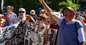 People shout outside the supreme court in Madrid last week as the court gave the green light for the Spanish government to remove the remains of Francisco Franco from a grandiose state mausoleum. Photograph: Javier Soriano/AFP/Getty Images