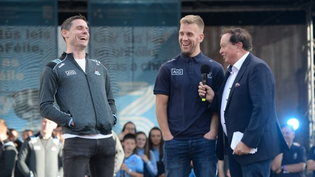 Dublin captain Stephen Cluxton with Johnny Cooper and broadcaster Marty Morrissey during the homecoming event at Merrion Square. Photograph: Dara Mac Dónaill