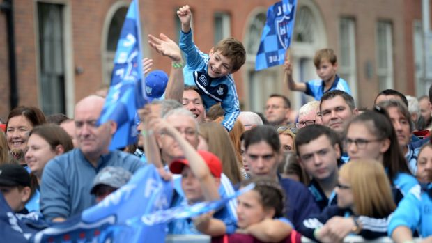 Fans throng Merrion Square to pay tribute to the All-Ireland-winning Dublin footballers. Photograph: Dara Mac Dónaill