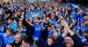Dublin fans during homecoming celebration marking the historic 'five-in-a-row' victory of the men's team and the 'three-in-a-row victory' for the women in Merrion Square. Photograph: Gareth Chaney/Collins