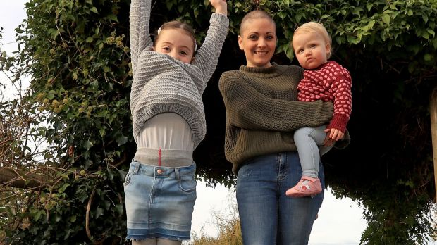 "Geraldine Walsh with her children Allegra and Devin: ""We can strike a balance between the demands of parenthood, the guilt we are often consumed by and the fact we are not super human."" Photograph: Donall Farmer"