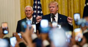 US president Donald Trump  with vice-president Mike Pence in the East Room of the White House in Washington. Photograph: /Susan Walsh