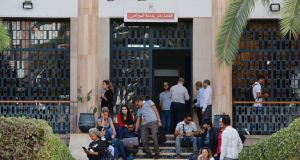 Members of the press sit outside a Moroccan court during the trial of Hajar Raissouni, a Moroccan journalist jailed for  alleged sexual relations outside marriage and an illegal abortion. Photograph: AFP