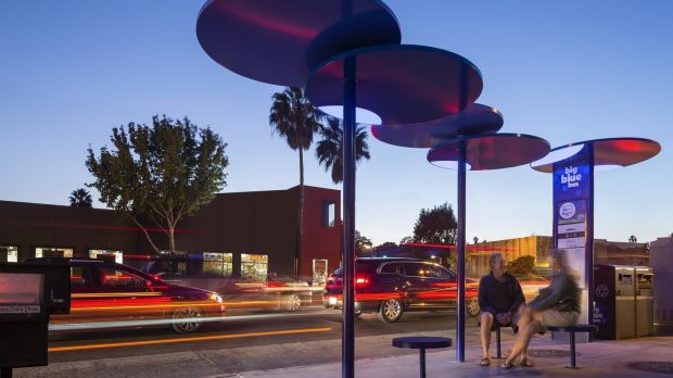 Bus shelters in Santa Monica, with disc-like canopies designed by Lorcan O'Herlihy