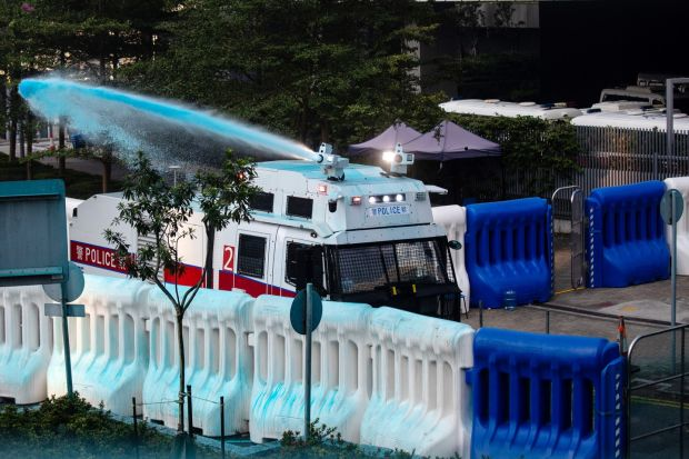 A water cannon sprays blue-dye outside the central government offices in the Admiralty district of Hong Kong. Photograph: Kyle Lam/Bloomberg