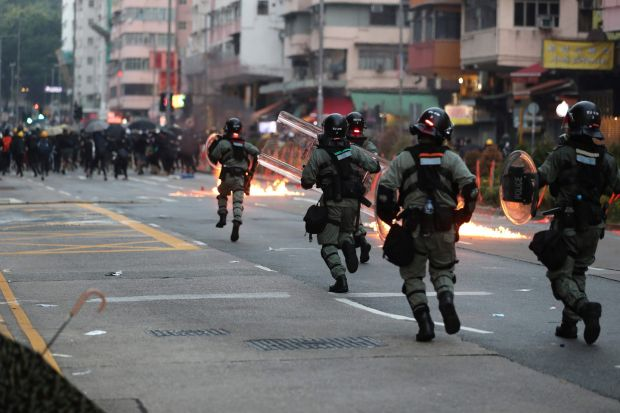 Hong Kong police advance on protesters during a demonstration in the Sham Shui Po area in Hong Kong. Photograph: May James / AFP