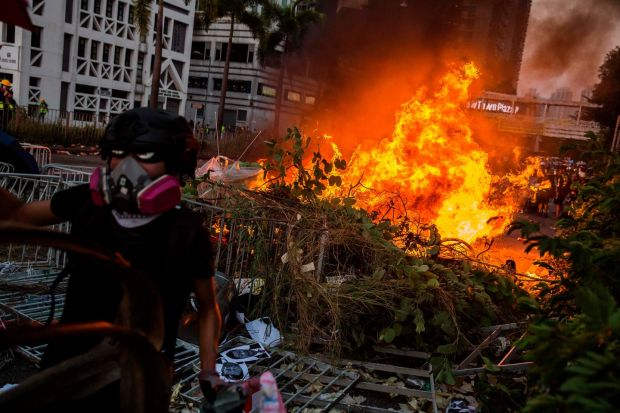 A fire lit by protesters burn in the Sha Tin district of Hong Kong. Photograph: Isaac Lawrence / AFP