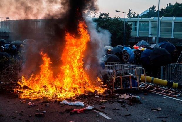 A fire lit by protesters burn in the Sha Tin district of Hong Kong. Photo: Isaac Lawrence / AFP