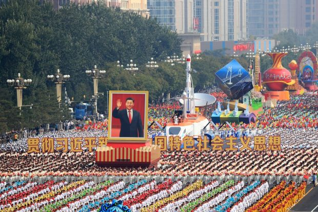 Performers take part in the parade on Tiananmen Square. Photograph: EPA/How Hwee Young