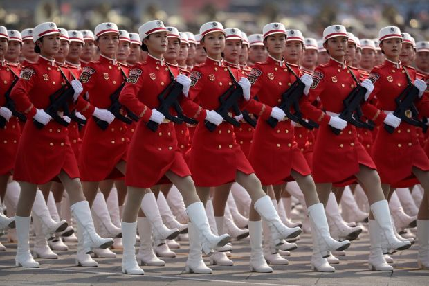 Chinese female militia members march in formation during the parade. Photo: Mark Schiefelbein