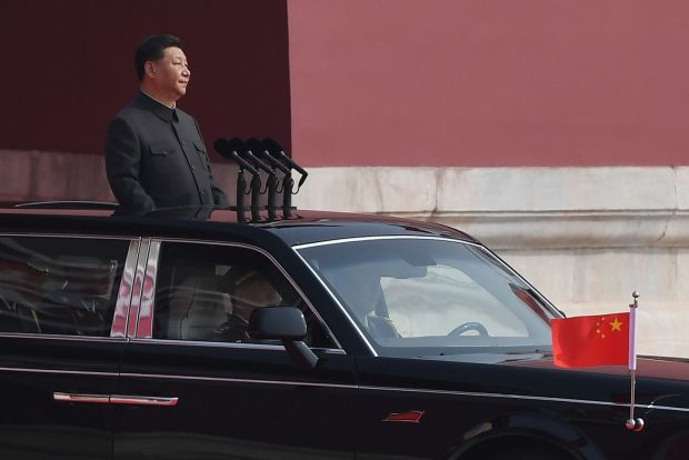 Chinese president Xi Jinping emerges from Tiananmen Gate before reviewing troops. Photograph: Greg Baker/AFP