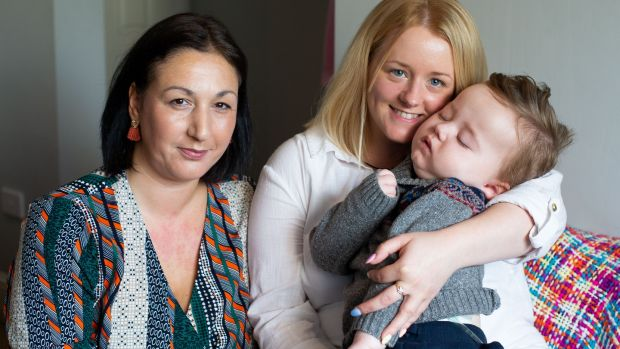 Kerrie Nelson and her son, James, with Jack and Jill nurse Naomi Jackson. 'I call her the baby whisperer,' says Kerrie. Photograph: Tom Honan