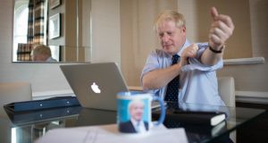 Britain's prime minister Boris Johnson prepares his keynote speech for the annual Conservative Party conference in Manchester. Photograph:  Stefan Rousseau /Getty Images