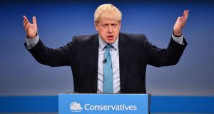 British prime minister Boris Johnson delivers his keynote speech to delegates on the final day of the annual Conservative Party conference at the Manchester Central convention complex. Photograph: Paul Ellis/AFP via Getty Images.