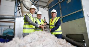 Trifol chief executive Daire Gilmore, Minister for Justice  Charlie Flanagan and Patrick Alley, founder and chairman of Trifol, at the company's  facility in Portlaoise, Co Laois. Photograph: Julien Behal