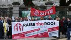 Representatives from political parties, trade unions and civil society groups outside Leinster House under the banner of Raise the Roof to demand that the Government implements a major motion on housing passed by the Dáil a year ago. Photograph: Laura Hutton/The Irish Times