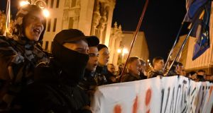 A few hundred protesters rallied in central Kiev on Tuesday night to denounce the plan, including members of far-right groups. Photograph: Genya Savilov/AFP/Getty Images