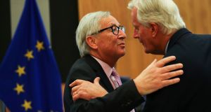 European Commission president Jean-Claude Juncker (left) greets EU chief Brexit negotiator Michel Barnier during a weekly meeting of the College of Commissioners in Brussels on Wednesday. Photograph: AP