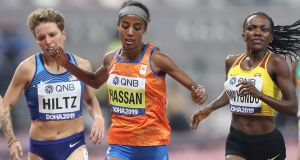 Netherlands' 10,000m champion Sifan Hassan  crosses the finish line ahead of USA's Nikki Hiltz  and Uganda's Winnie Nanyondo in the Women's 1500m heats  at the  World Championships in  Doha. Photograph: Karim Jaafar/AFP/Getty
