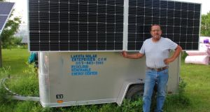 "Henry Red Cloud's solar-powered battery trailer: ""It'd run one-third of your house easily.""  Photograph: Stephen Starr"
