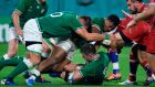 Ireland's Bundee Aki adds his weight to a ruck as  scrumhalf Luke McGrath holds on to the ball against Russia at the Kobe Misaki Stadium. Photograph: Getty Images