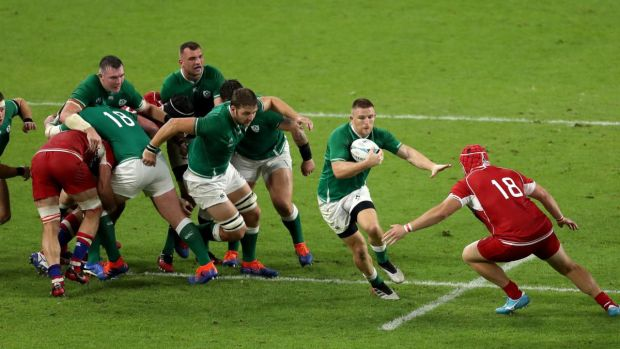 Andrew Conway looks to break past Vladimir Podrezov during Ireland's win over Russia. Photograph: Mike Hewitt/Getty