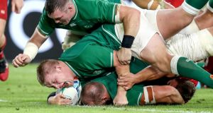 Ireland's Rhys Ruddock scores their third try with a little help from John Ryan and Peter O'Mahony. Photograph: Dan Sheridan/Inpho