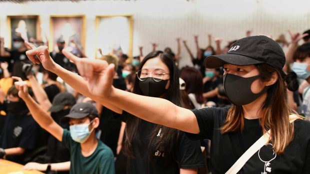Student protesters in a meeting room after forcing their way into the administrative offices at the Chinese University of Hong Kong on Thursday. Photograph: Mohd Rasfan/AFP via Getty Images