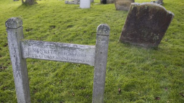 The grave marker of Edith Nesbit, the English author and poet whose children's works were published under the name of E Nesbit. Photograph: Gideon Mendel/Corbis
