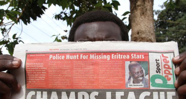Recurring issue: a newspaper in Kampala carries a report on Eritrean footballers who disappeared from a hotel they were staying in the Council for East and Central Africa Football Associations in 2012. Photograph: Isaac Kasamani/AFP/Getty