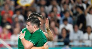 Garry Ringrose   with  Luke McGrath after the centre scored Ireland's fifth try against on Thursday. Photograph: Getty Images